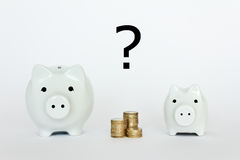 2 piggybanks coins question mark Stock Photos