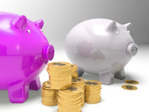 Piggybanks And Coins Showing American Earnings Royalty Free Stock Photography