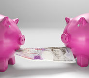 Piggybanks Eating Money Shows Shared Savings. Or Family Budget Royalty Free Stock Photo