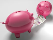 Piggybanks Fighting Over Money Shows Investment. Decisions Or Risks Royalty Free Stock Photos