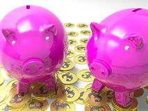 Piggybanks On Pound Coins Shows Wealthy Savings Royalty Free Stock Photo