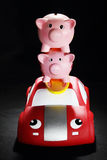 Piggybanks on Toy Car Royalty Free Stock Photos