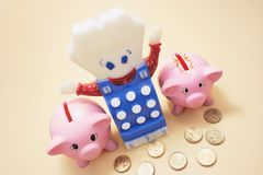 Piggybanks and Toy Cash Register Royalty Free Stock Images