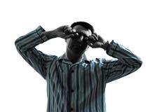 Pigiami dell'uomo che svegliano allungando le siluette Fotografia Stock