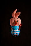 Piglet rubber baby toy. On a black background Stock Photo