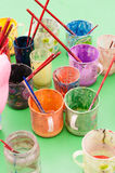 Pigment cups. Pigment in cups,green background Royalty Free Stock Photo