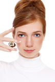 Pigmentation. Young red-haired girl with freckles holding quail egg in her hand, on white background Stock Photo