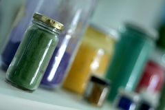 Pigments. Of several colors in pots Royalty Free Stock Photo