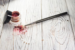 Pigments, glitter, brushes. Studio photo on a wooden background Royalty Free Stock Images