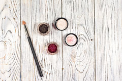Pigments, glitter. Make up set. Studio photo on a wooden background Royalty Free Stock Photography
