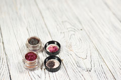 Pigments, glitter. Make up set. Studio photo on a wooden background Royalty Free Stock Images