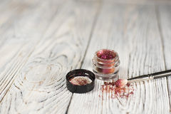 Pigments, glitter. Make up set. Studio photo on a wooden background Stock Photo