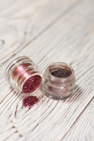 Pigments, glitter. Make up set. Studio photo on a wooden background Stock Photography