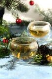 Pigna calda di vetro del tè di natale Fotografia Stock