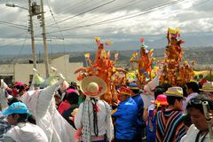 Pigs adorned with fruits, spirits, flags and. Latacunga, Ecuador 30 September, 2012: Unidentified participants parade pigs adorned with fruits, spirits, flags royalty free stock photo