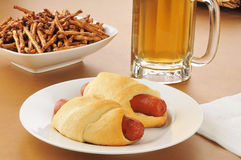Pigs in a blanket. Or glory dogs, with beer and pretzels Stock Photos