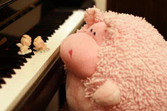 Pigs dancing on piano Royalty Free Stock Image