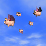 When Pigs Fly 2. Five Piggy Banks flying away with your investments Stock Photo