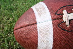 Pigskin. Football shot angling into the photo on grass Stock Photography