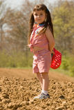 Pigtail Girl on Scavenger Hunt Stock Photo