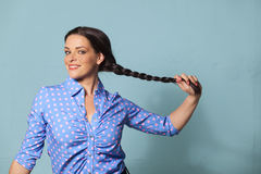 Pigtail. Smiling woman with a pigtail Stock Photos