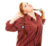 Pigtail young red hair woman Royalty Free Stock Images