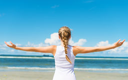 Pigtailed girl on the beach. Royalty Free Stock Image