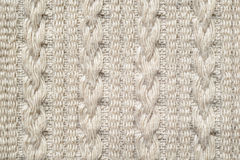 Pigtails on Beige Knitwear Fabric Texture. Machine Knitting Texture Macro Snapshot. Beige Knitted Background stock photo