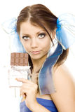 Pigtails girl with chocolate enjoy Royalty Free Stock Photo