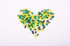 Pigułki, żywienioniowi nadprogramy, narkotyzują tworzyć serce Fotografia Stock