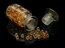 Pigułki z wątróbka olejem Obrazy Stock