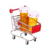 Pigułki butelka w wózek na zakupy na bielu Zdjęcia Stock