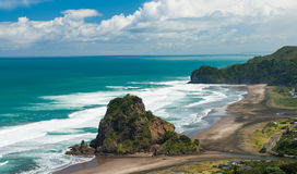 Piha beach. Beautiful Piha beach near Auckland with a mighty Lion Rock, New Zealand Royalty Free Stock Photos