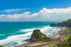 Piha beach. Beautiful Piha beach near Auckland with a mighty Lion Rock, New Zealand Royalty Free Stock Images