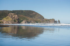 Piha beach at low tide. Piha beach in New Zealand at low tide royalty free stock photo