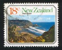 Piha Beach. NEW ZEALAND - CIRCA 1977: stamp printed by New Zealand, shows Ocean Beach, Piha Beach, circa 1977 stock photos