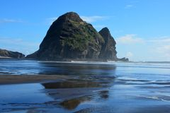 Piha beach in New Zealand. Piha beach with rock formations at the background in New Zealand royalty free stock photos