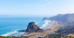 Piha beach in new zealand. View at lion rock and piha beach at north island in new zealand Stock Photo