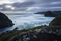 Piha Beach, NZ. Piha beach on Auckland's rugged westcoast in a winter storm stock image
