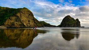 Piha beach, a popular black sand beach for recreational activities in New Zealand. Piha beach, a popular black sand beach for recreational activities in Auckland stock photos