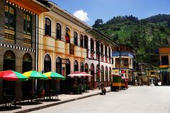 PIJAO, COLOMBIA - AUGUST 14, 2018: Street scene in Pijao, wellknown village in Colombia for coffee culture. Pijao is a municipality in the south-eastern part of stock photography