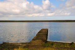 Pijler aan lagune Stock Foto