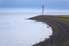 Pijler bij de haven van Lauwersoog Stock Afbeelding