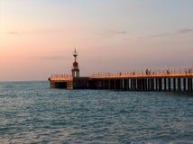 Pijler bij zonsondergang Stock Foto's