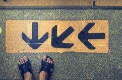 Pijlteken met voet Stock Foto's