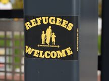 Refugees welcome sticker on a lamppost. Pijnacker, the Netherlands. October 2018. A sticker on a lamppost by an organisation called the Anti Fascistische Aktie stock photos