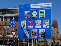 Billboard for the elections of the municipal council in the Netherlands in 2018. Pijnacker Nootdorp, the Netherlands. February 2018. Billboard with candidates Stock Images