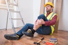 Pijnlijke arbeider na op de baanverwonding Royalty-vrije Stock Afbeelding
