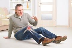 Pijnlijke knie Stock Foto's