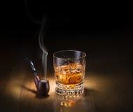 Pijp en whisky Stock Foto's